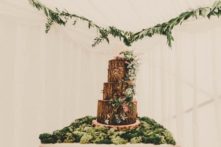 Rustic Log Wood Slice Cake Moss Buttercream Rose Gold Sequins Greenery Musical Wedding https://www.jademaguirephotography.uk/