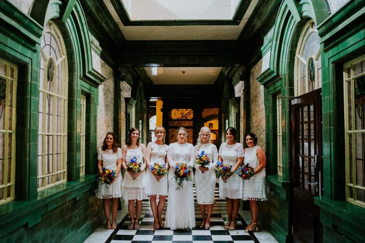 White Mismatched Bridesmaid Dresses Colourful Cool Humanist Pool Wedding http://www.stevebridgwoodphotography.co.uk/