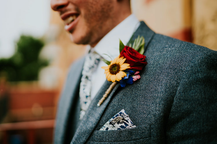 Buttonhole Groom Red Rose Yellow Sunflower Colourful Cool Humanist Pool Wedding http://www.stevebridgwoodphotography.co.uk/