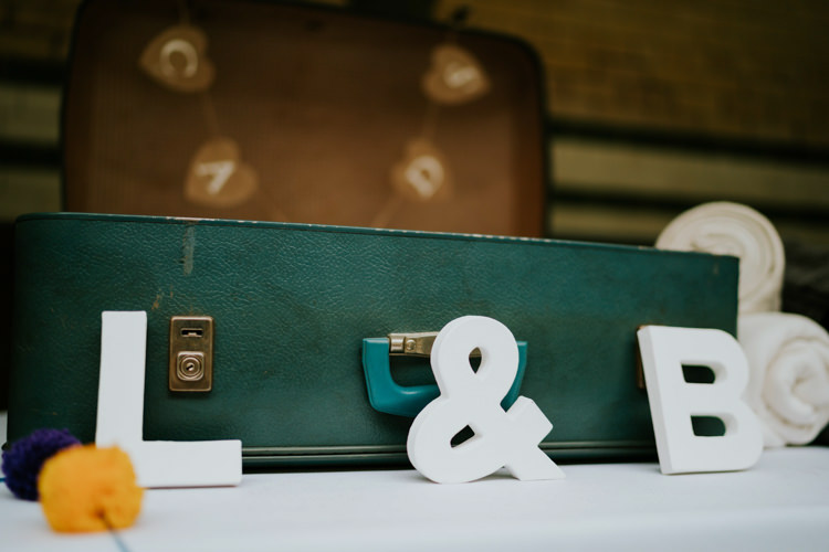 Card Suitcase Colourful Cool Humanist Pool Wedding http://www.stevebridgwoodphotography.co.uk/