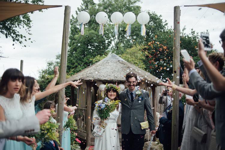 Bride Bridal Flower Crown Wildflower Bouquet Meadow long Sleeve Silk Dress 70s Grey Tweed Groom Mismatched Separates Confetti Shot Moment Adventurous Festival Bohemian Wedding https://libertypearlphotography.com/