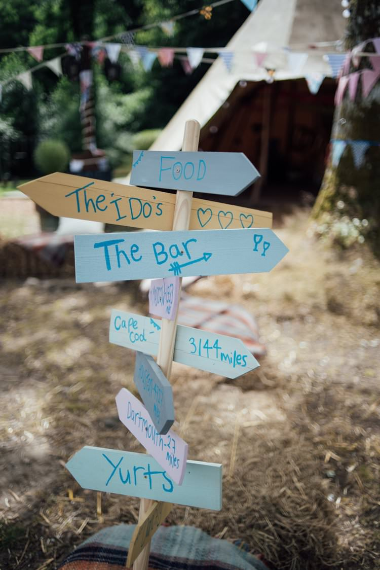 DIY Wood Signpost Directions Homemade Adventurous Festival Bohemian Wedding https://libertypearlphotography.com/