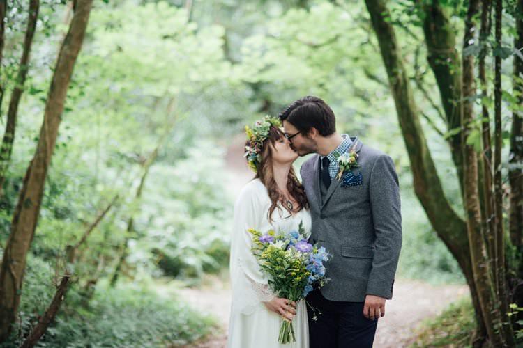 Bride Bridal Flower Crown Wildflower Bouquet Meadow long Sleeve Silk Dress 70s Grey Tweed Suit Navy Trousers Gingham Shirt Blue Adventurous Festival Bohemian Wedding https://libertypearlphotography.com/