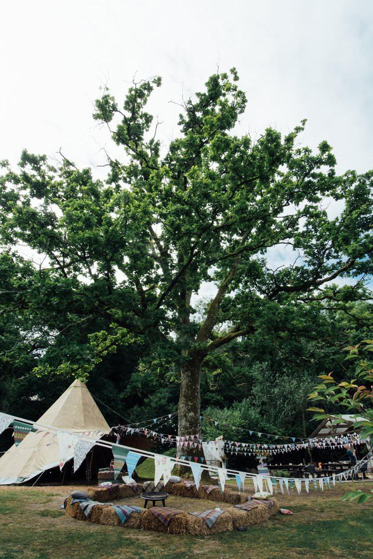 Straw Hay Bales Bunting Adventurous Fire Pit Tipi Blankets Plaid Tartan Festival Bohemian Wedding https://libertypearlphotography.com/