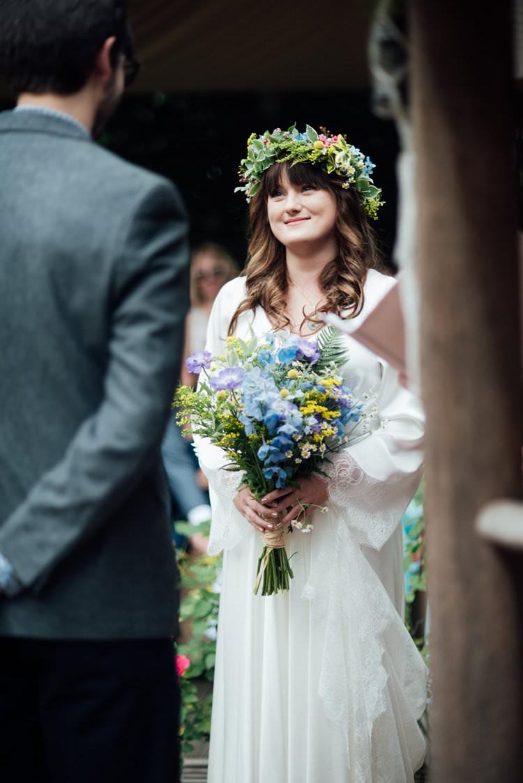 Bride Bridal Flower Crown Wildflower Bouquet Meadow long Sleeve Silk Dress Gown 70s Adventurous Festival Bohemian Wedding https://libertypearlphotography.com/