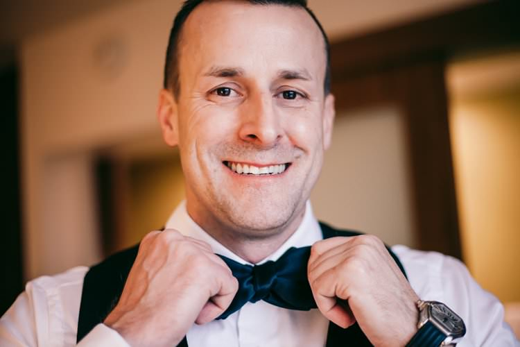 Morning Groom Prep Navy Suit Bow Tie Smile Waistcoat | Festive Glamour Christmas New Years Eve Wedding http://www.stevendrayimages.com/
