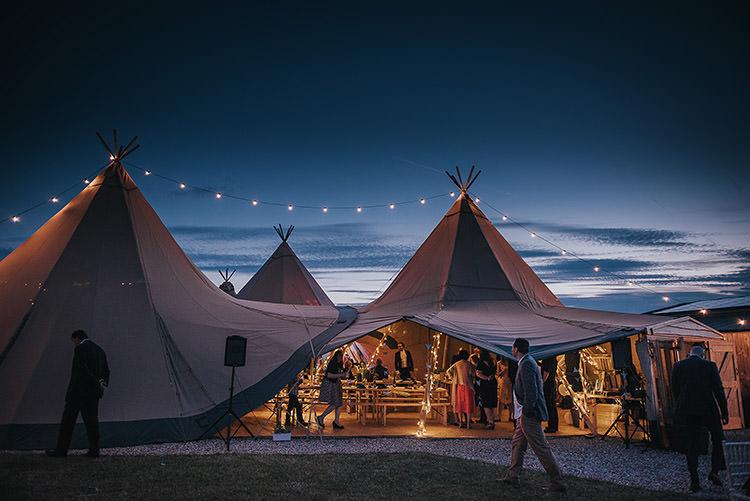 Tipi Lighting Festoons Happy Crafty Summer Farm Wedding http://twigandvine.photography/