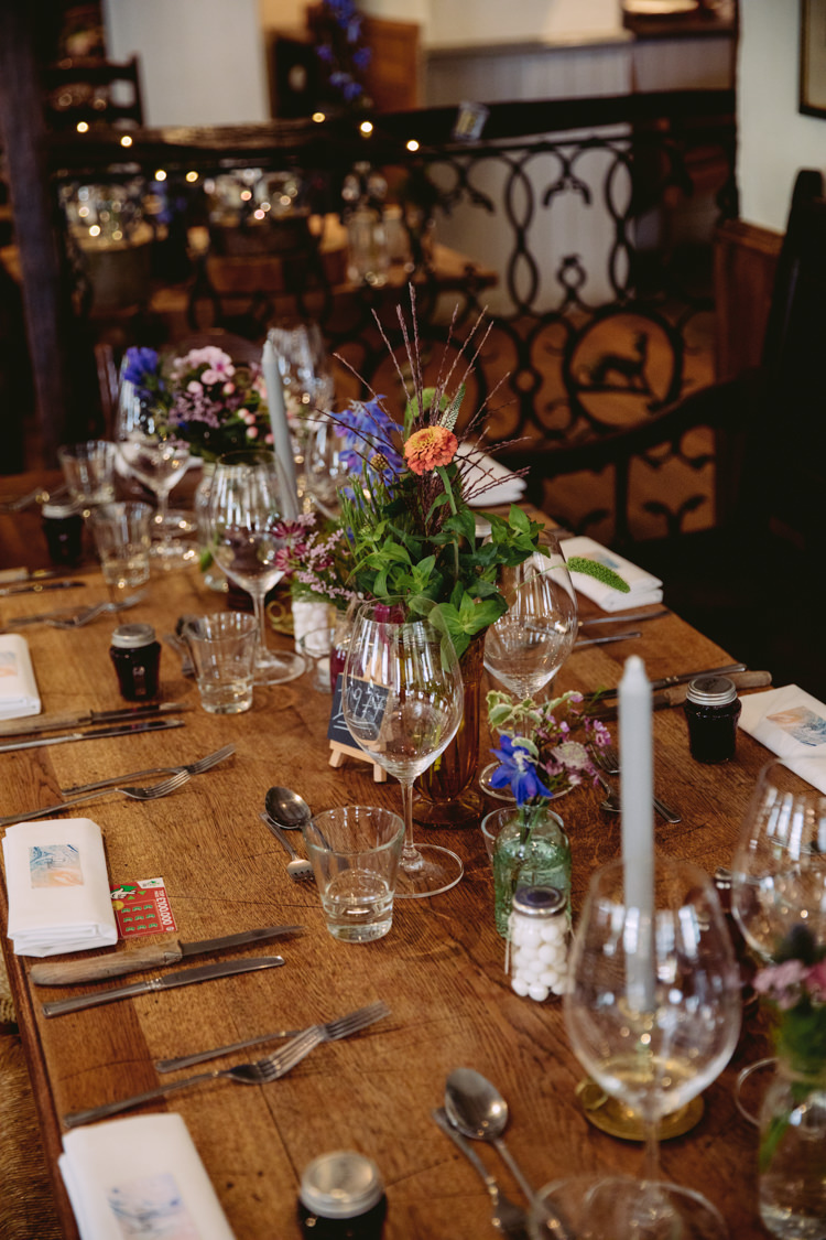 Bottle Jar Flowers Floral Mismatched Glass Candle Sticks Rustic Cosy Autumn Wedding Lake District http://hayleybaxterphotography.com/