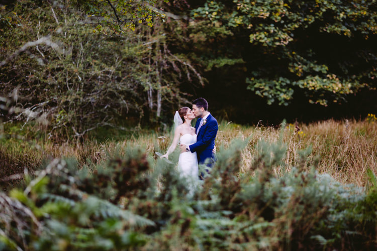 Bride Bridal Enzoani Fishtail Dress Gown Long Veil Navy Suit Rustic Cosy Autumn Wedding Lake District http://hayleybaxterphotography.com/