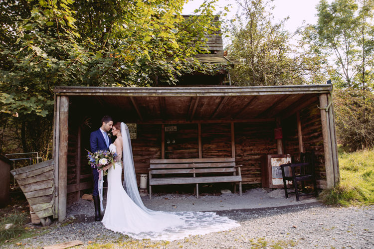 Bride Bridal Enzoani Fishtail Dress Gown Long Veil Navy Suit Rustic Cosy Autumn Wedding Lake District http://hayleybaxterphotography.com/