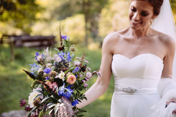 Bride Bridal Sweetheart Neckline Long Veil Bouquet Floral Wild Flower Feather Cornflower Fern Diamante Belt Rustic Cosy Autumn Wedding Lake District http://hayleybaxterphotography.com/