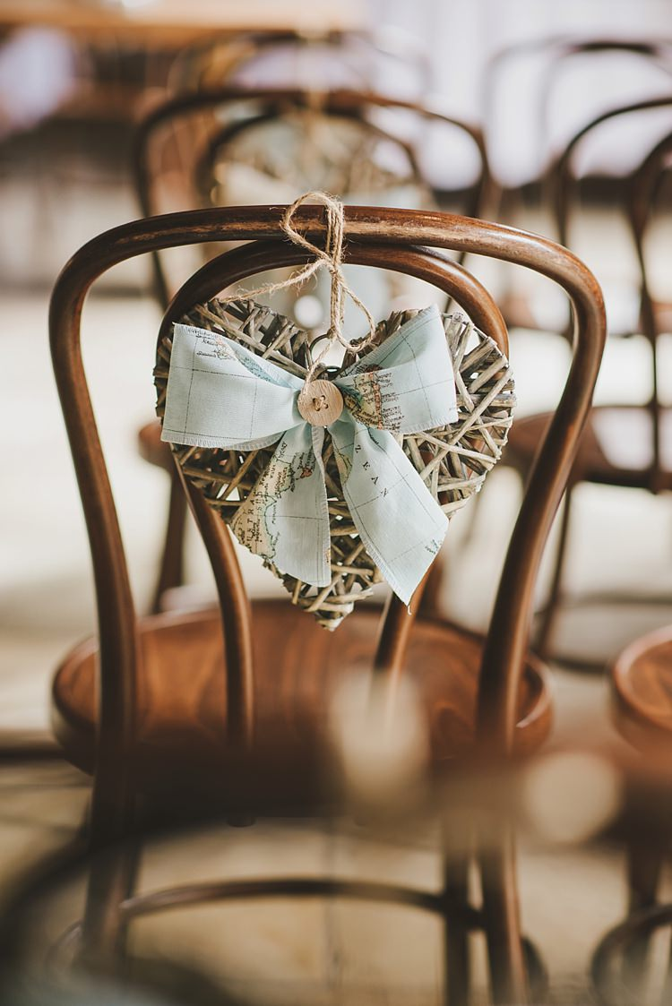 Chair Wicker Heart Ribbon Untraditional Pretty Travel Barn Wedding https://www.georgimabee.com/