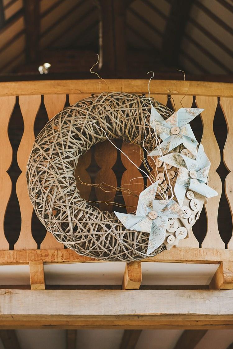 Wicker Wreath Pinwheels Decor Untraditional Pretty Travel Barn Wedding https://www.georgimabee.com/