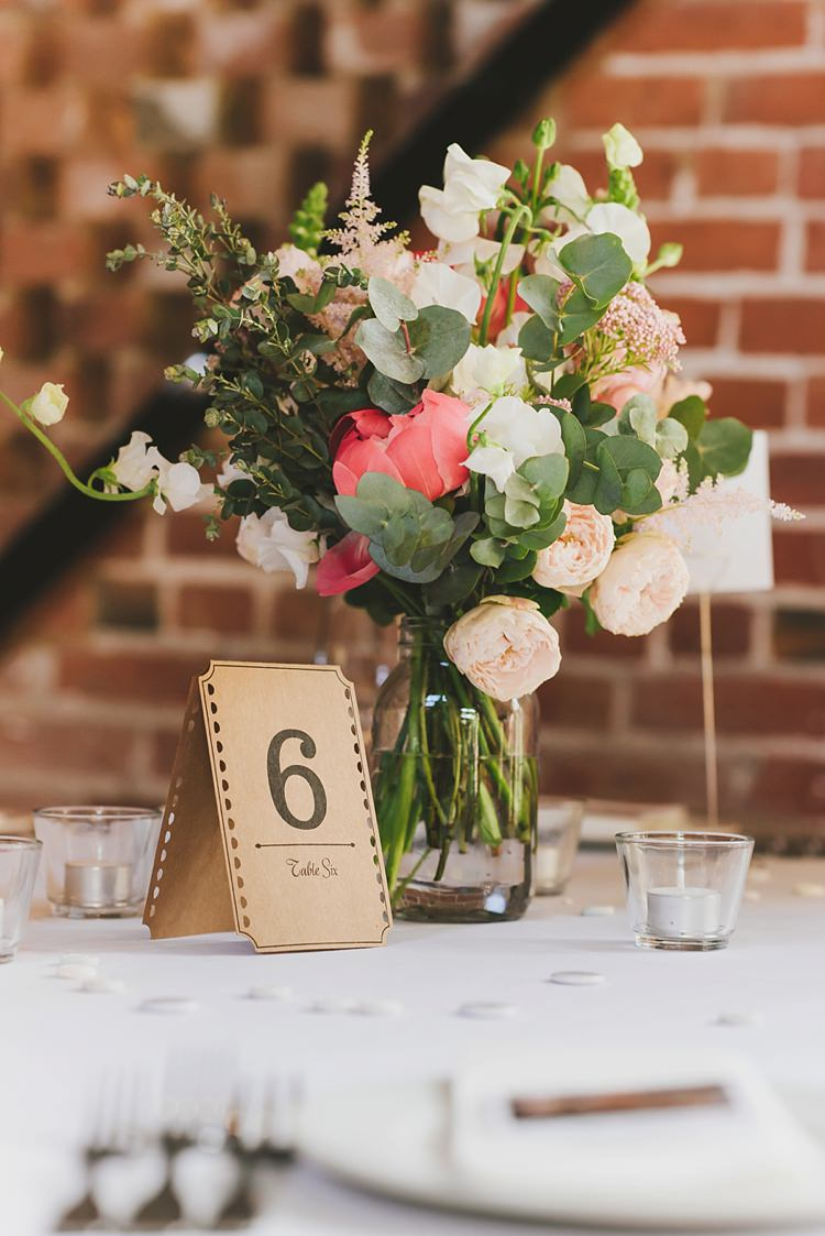 Table Number Flowers Decor Untraditional Pretty Travel Barn Wedding https://www.georgimabee.com/