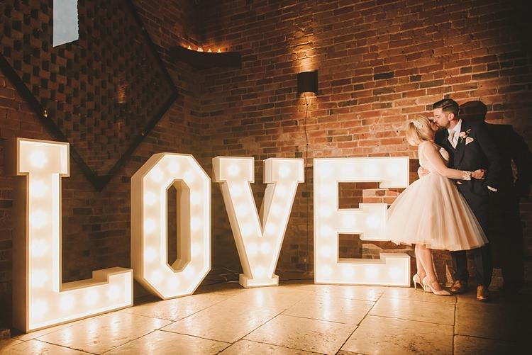 LOVE Letter Lights Untraditional Pretty Travel Barn Wedding https://www.georgimabee.com/