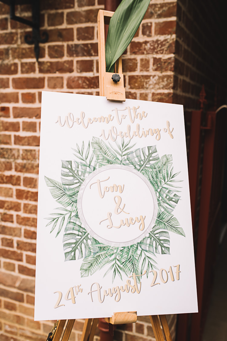 Sign Leaves Tropical Boho Luxe Barn Wedding https://www.luciewatsonphotography.com/