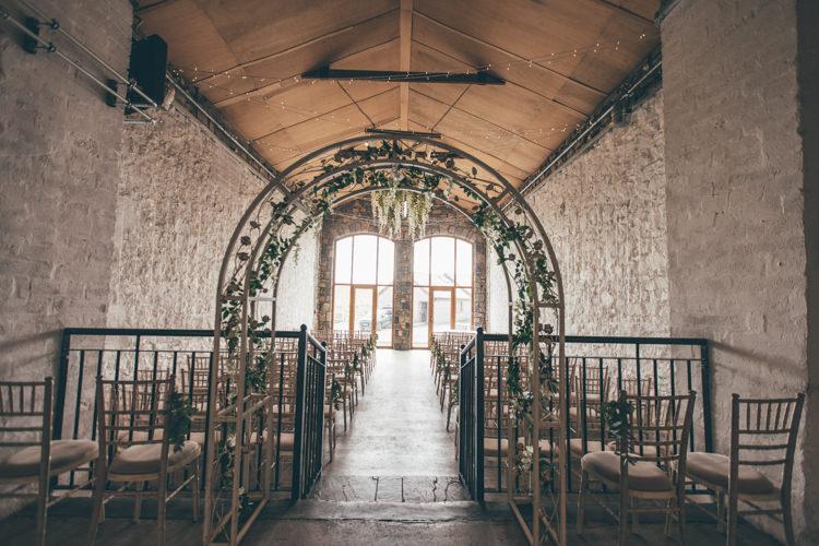 Ivy Arch Ceremony Farm Barn Stone Natural Earthy Greenery Home Made Wedding http://rachellambertphotography.co.uk/