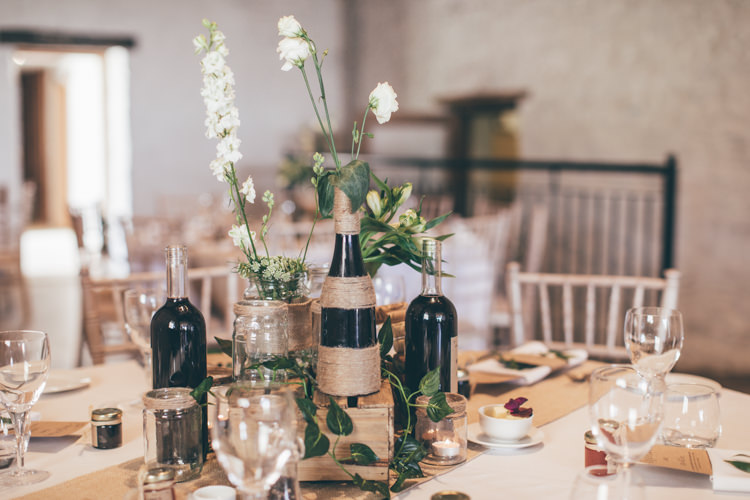 Table Decor Centrepiece Flowers Jars Bottles Hessian Natural Earthy Greenery Home Made Wedding http://rachellambertphotography.co.uk/