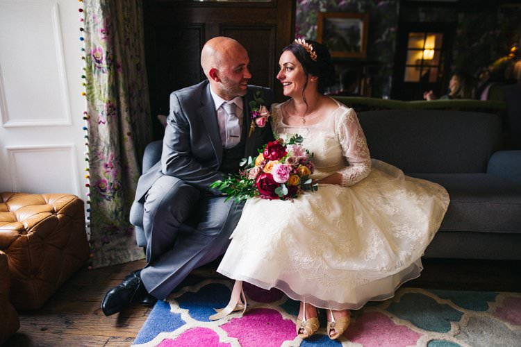 Bride Bridal Tea Length Louise Bentley Lace Three Quarter Sleeve T-Bar Shoes Rose Gold Leaf Crown Grey Suit Groom Jewel Tone Bouquet Peony Rose Colourful Floral Family Friendly Wedding http://www.sallytphoto.com/