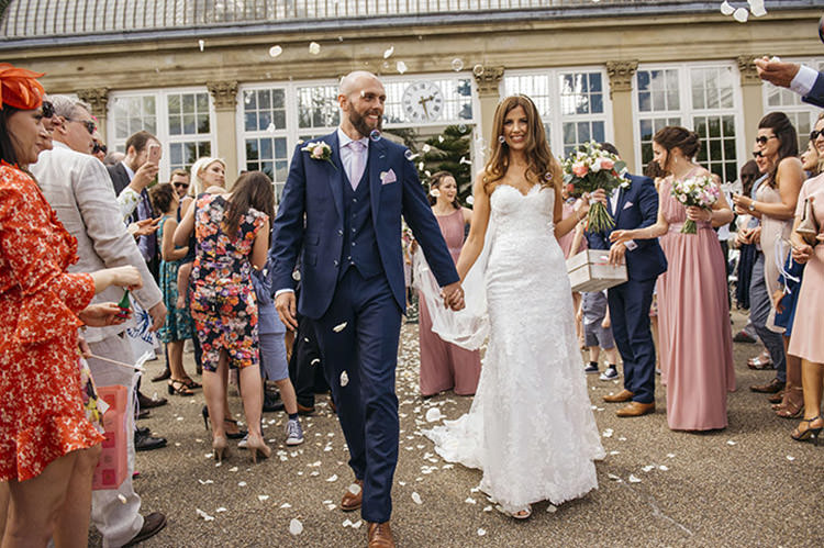 Bride Bridal Gown Dress Essence of Australia Sweetheart Neckline Cathedral Veil Fishtail Three Piece Suit Waistcoat Groom Navy Confetti Shot Moment Pretty Floral Boho Tipi Wedding https://www.kindredphotography.co.uk/