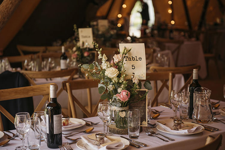 Table Centre Rustic Wood Slice Log Roses Pretty Floral Boho Tipi Wedding https://www.kindredphotography.co.uk/