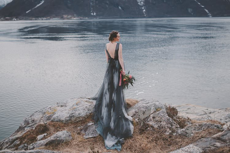 Bride Grey Black Couture Dress Updo Bouquet Norway Mountain Elopement | Moody Chic Norwegian Fjord Wedding Ideas https://www.anoukfotografeert.nl/