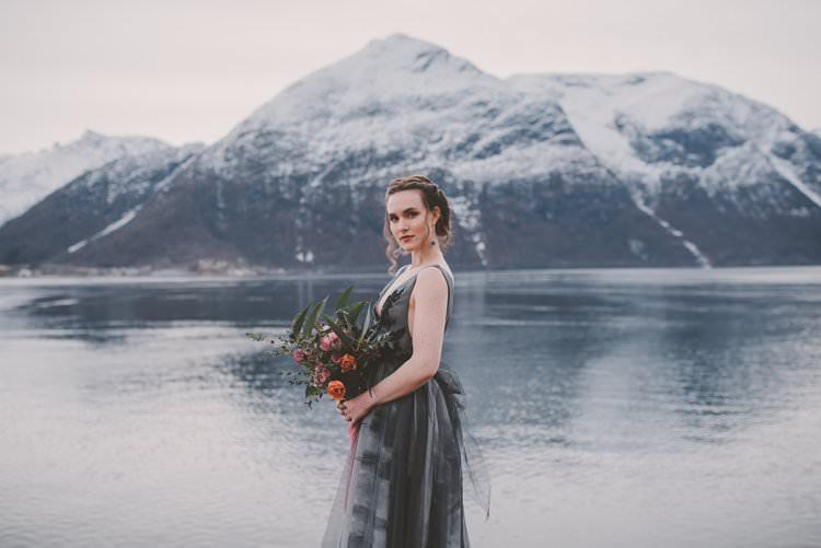 Bride Grey Black Couture Dress Updo Bouquet Norway Mountain Elopement | Moody Chic Norwegian Fjord Wedding Ideas https://www.anoukfotografeert.nl/