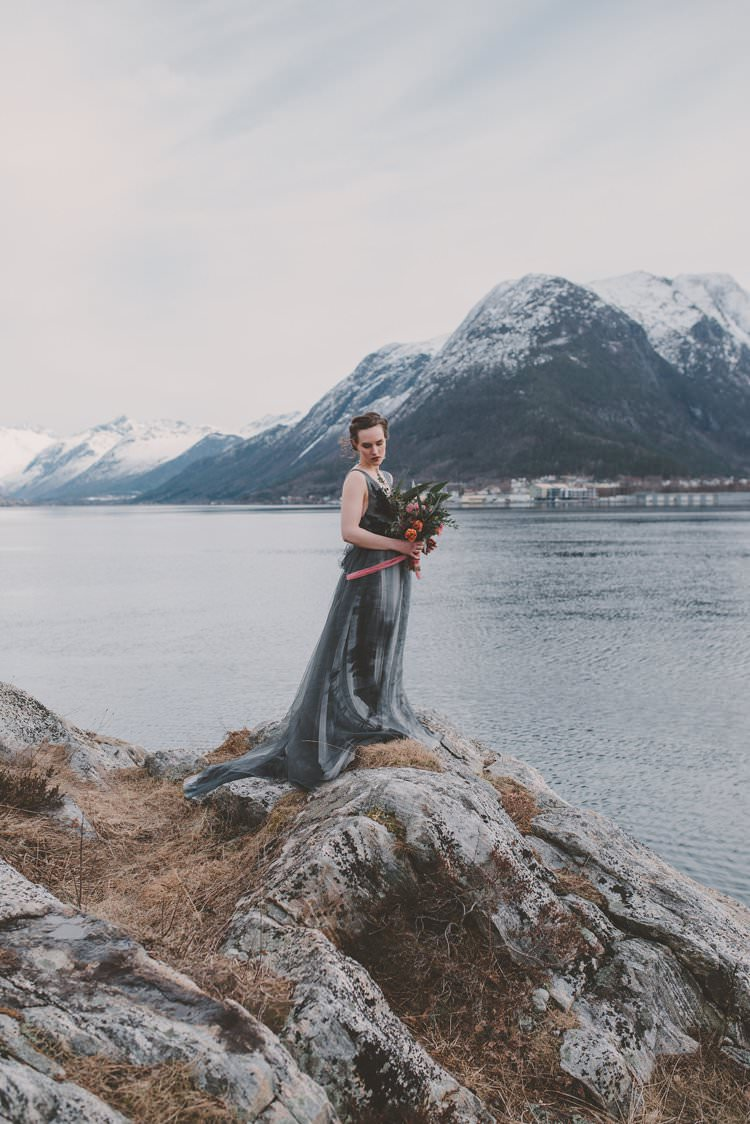 Bride Grey Black Couture Dress Norway Mountain Elopement | Moody Chic Norwegian Fjord Wedding Ideas https://www.anoukfotografeert.nl/
