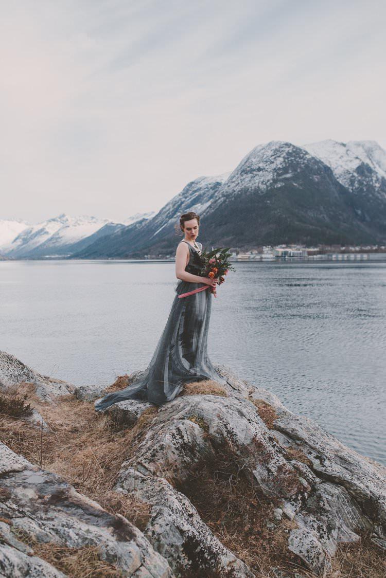 Bride Grey Black Couture Dress Norway Mountain Elopement | Moody Chic Norwegian Fjord Wedding Ideas https://www.anoukfotografeert.nl/