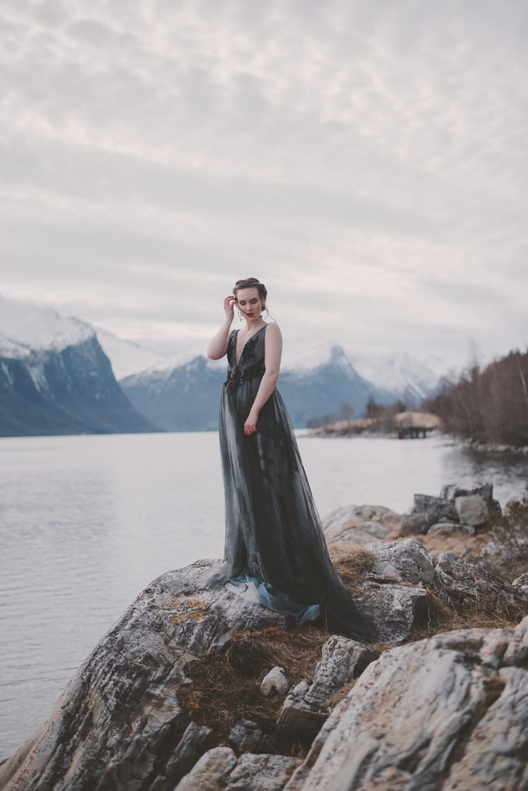 Bride Grey Black Couture Dress Updo Norway Mountain Elopement | Moody Chic Norwegian Fjord Wedding Ideas https://www.anoukfotografeert.nl/
