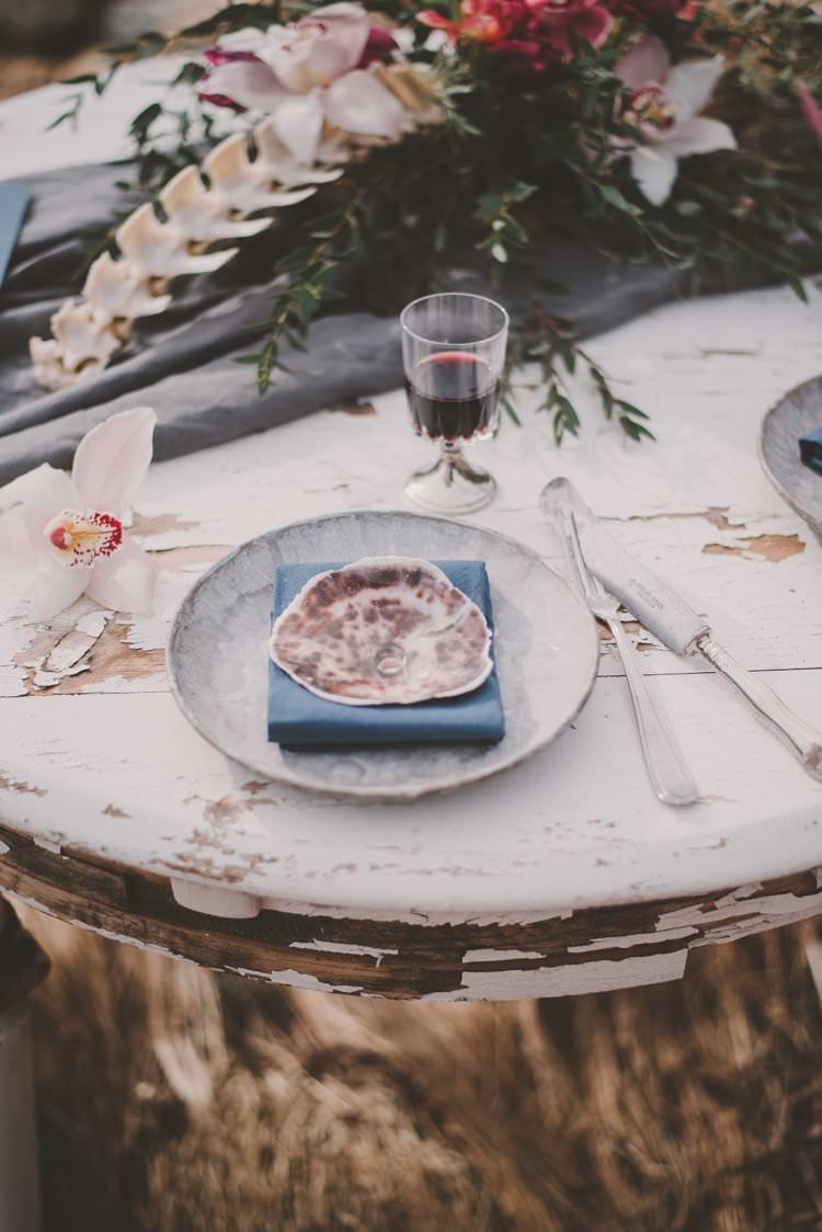 Table Blue Shell Bone Orchid Centrepiece Norway Mountain Elopement | Moody Chic Norwegian Fjord Wedding Ideas https://www.anoukfotografeert.nl/