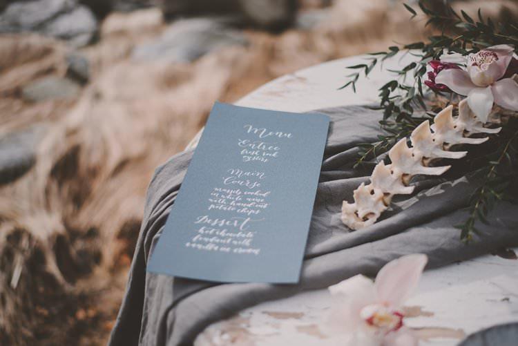 Blue Menu Bone Flower Centerpiece Minimalist Norway Mountain Elopement | Moody Chic Norwegian Fjord Wedding Ideas https://www.anoukfotografeert.nl/