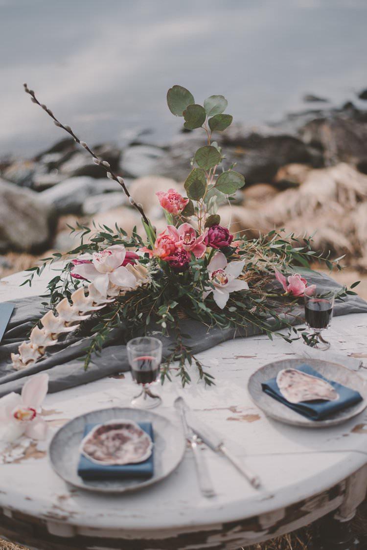 Table Runner Floral Centerpiece Bone Blue Shell Norway Mountain Elopement | Moody Chic Norwegian Fjord Wedding Ideas https://www.anoukfotografeert.nl/