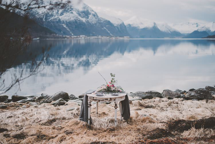 Table Grey Minimalist Flower Centerpiece Norway Mountain Elopement | Moody Chic Norwegian Fjord Wedding Ideas https://www.anoukfotografeert.nl/