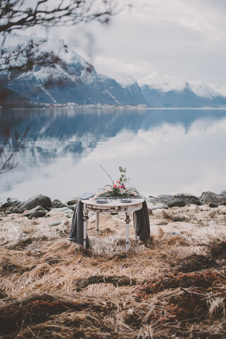 Table Grey Minimalist Flower Centerpiece Norway Mountain Elopement | Moody Chic Norwegian Fjord Wedding Ideas https://www.anoukfotografeert.nl/