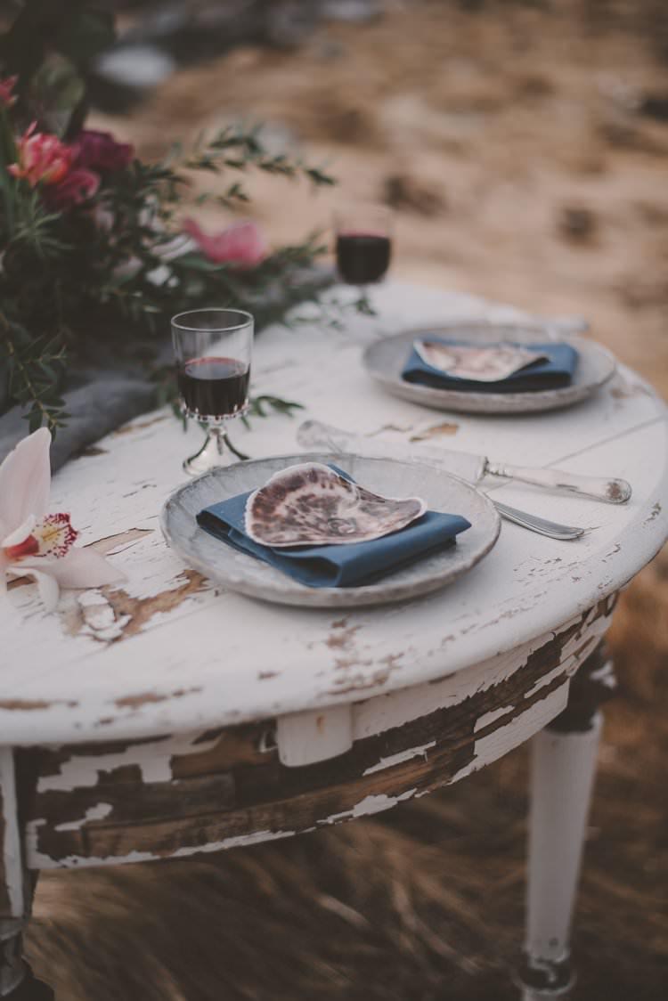 Table Grey Blue Shell Minimalist Flower Centerpiece Norway Mountain Elopement | Moody Chic Norwegian Fjord Wedding Ideas https://www.anoukfotografeert.nl/