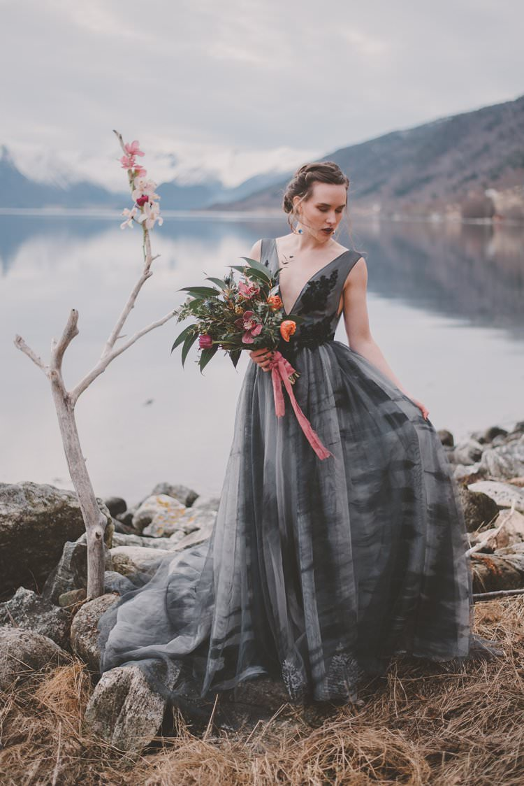 Bride Grey Bouquet Pink Orchid Minimalist Norway Mountain Elopement | Moody Chic Norwegian Fjord Wedding Ideas https://www.anoukfotografeert.nl/