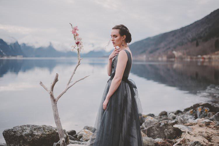 Bride Grey Dress Updo Minimalist Norway Mountain Elopement | Moody Chic Norwegian Fjord Wedding Ideas https://www.anoukfotografeert.nl/
