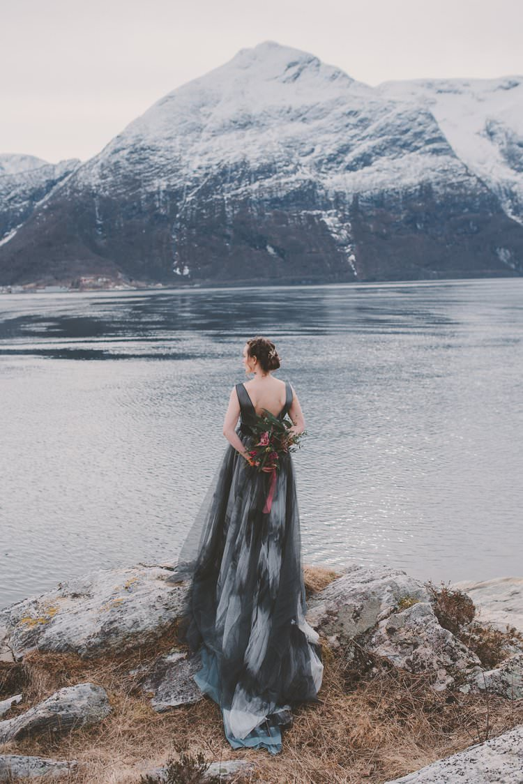 Bride Grey Black Couture Dress Bouquet Norway Mountain Elopement | Moody Chic Norwegian Fjord Wedding Ideas https://www.anoukfotografeert.nl/