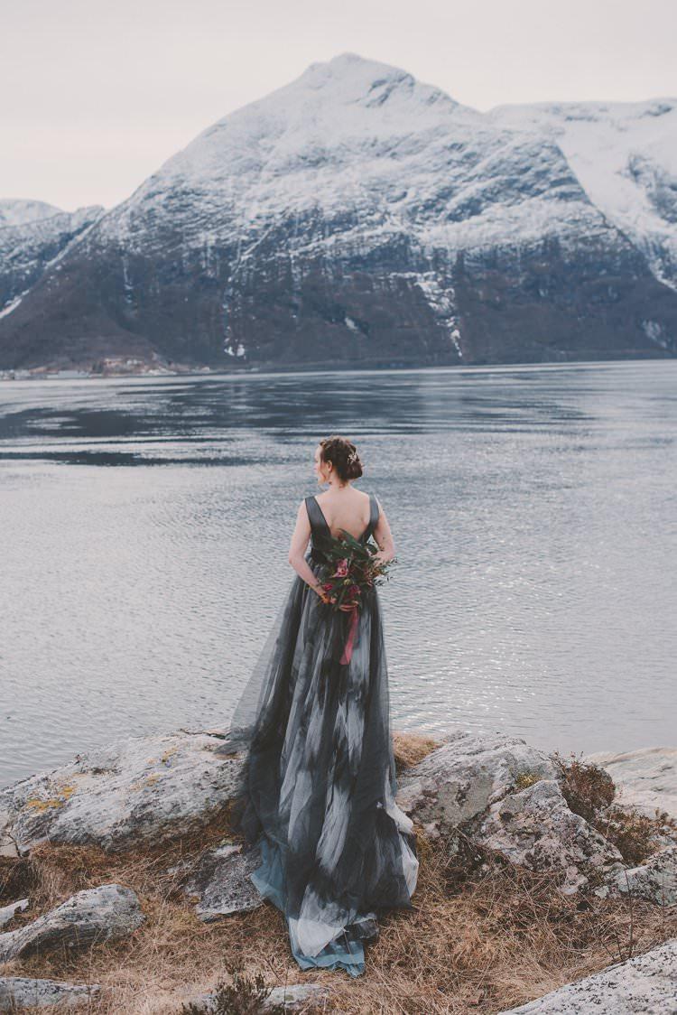 Bride Grey Black Couture Dress Bouquet Norway Mountain Elopement | Moody Chic Norwegian Fjord Wedding Ideas https://www.anoukfotografeert.nl/