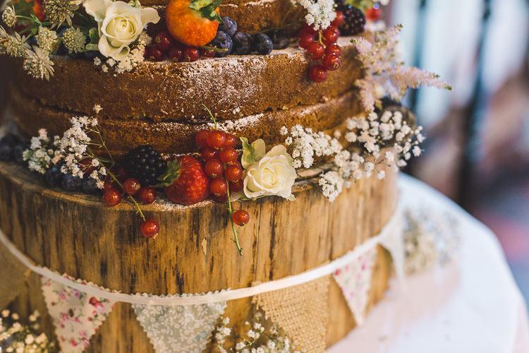 Naked Cake Wood Slice Tree Stand Bunting Fruit Whimsical Romantic Barn Wedding http://kirstymackenziephotography.co.uk/