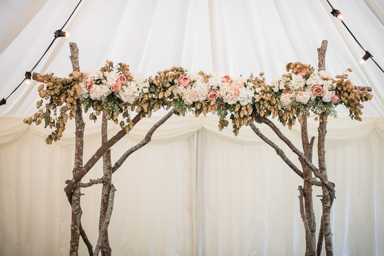 Ceremony Backdrop Tree Wood Hops Pastel Flowers Floral Arbour Personal Homegrown Country Farm Wedding https://www.emmahare.com/