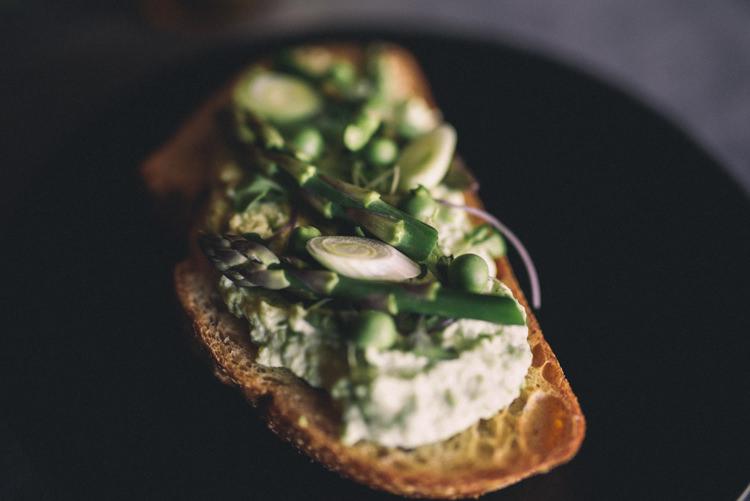 Dark Moody Black Plates Green Food Asparagus Cream Bread | Edgy Emerald City Wedding Ideas http://www.yvonnegollphotography.com/
