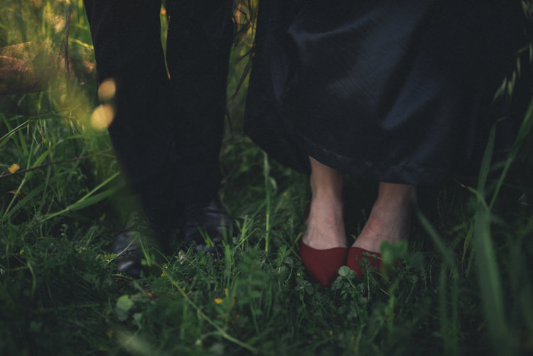 Dark Moody Black Dress Bride Groom Red Shoes Grass Outdoor | Edgy Emerald City Wedding Ideas http://www.yvonnegollphotography.com/