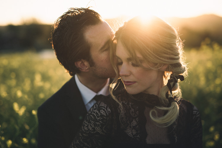 Dark Moody Black Dress Green Field Outdoor Kiss Groom Bride Braid | Edgy Emerald City Wedding Ideas http://www.yvonnegollphotography.com/