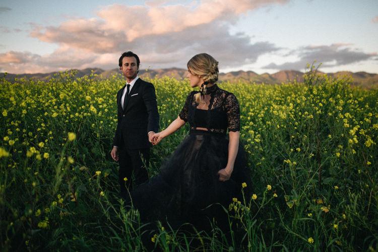 Dark Moody Black Dress Yellow Flowers Lace Sleeves Braid Bride | Edgy Emerald City Wedding Ideas http://www.yvonnegollphotography.com/