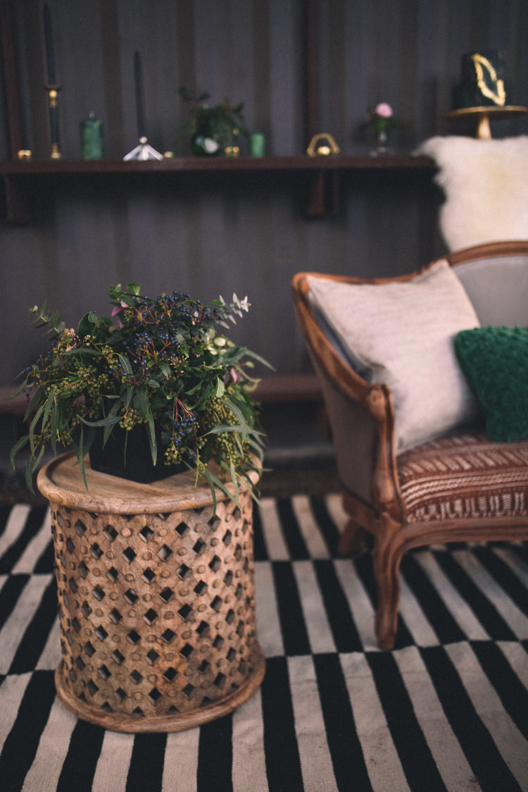 Dark Moody Lounge Gold Green Decor Striped Rug Sofa | Edgy Emerald City Wedding Ideas http://www.yvonnegollphotography.com/