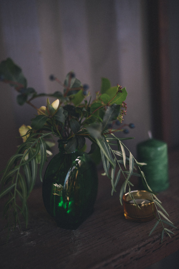 Dark Moody Green Decor Vase Flowers Candle Gold Tealight | Edgy Emerald City Wedding Ideas http://www.yvonnegollphotography.com/