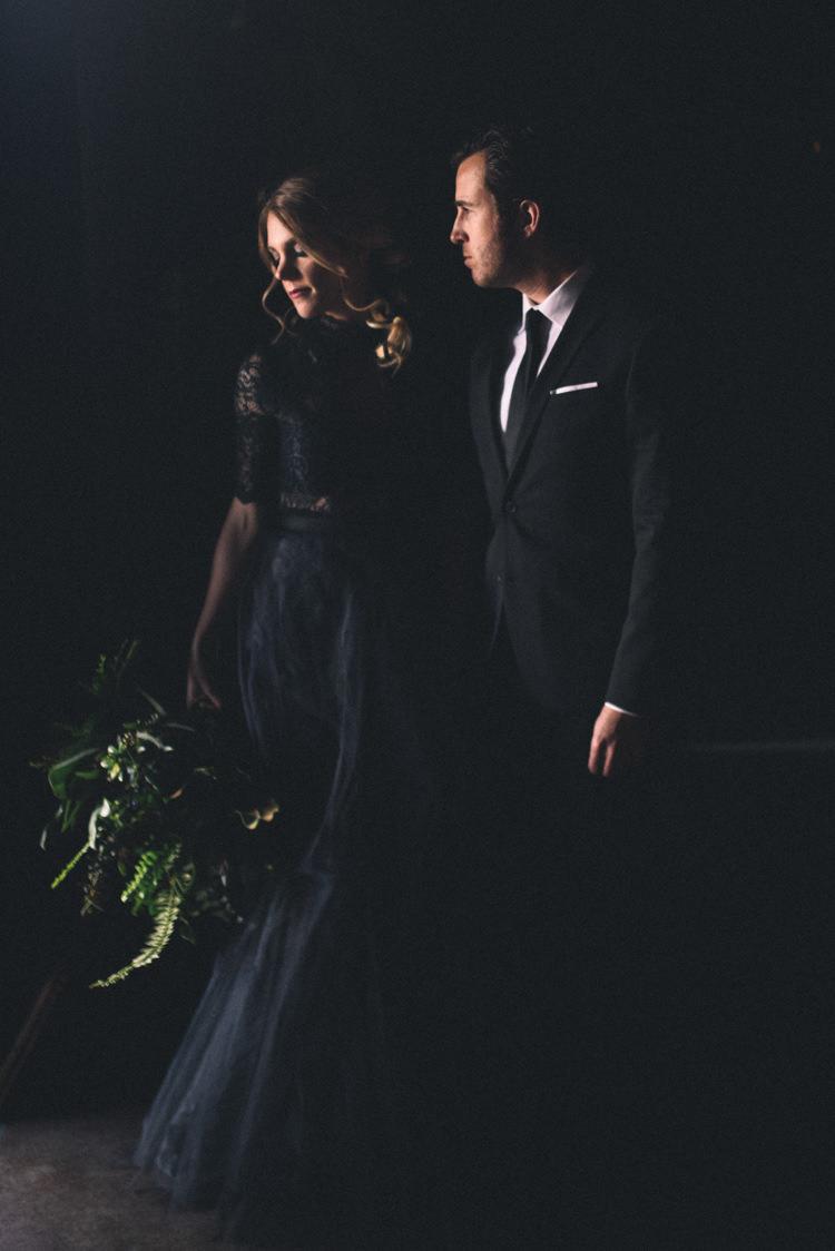 Dark Moody Black Dress Bride Groom Green Bouquet | Edgy Emerald City Wedding Ideas http://www.yvonnegollphotography.com/