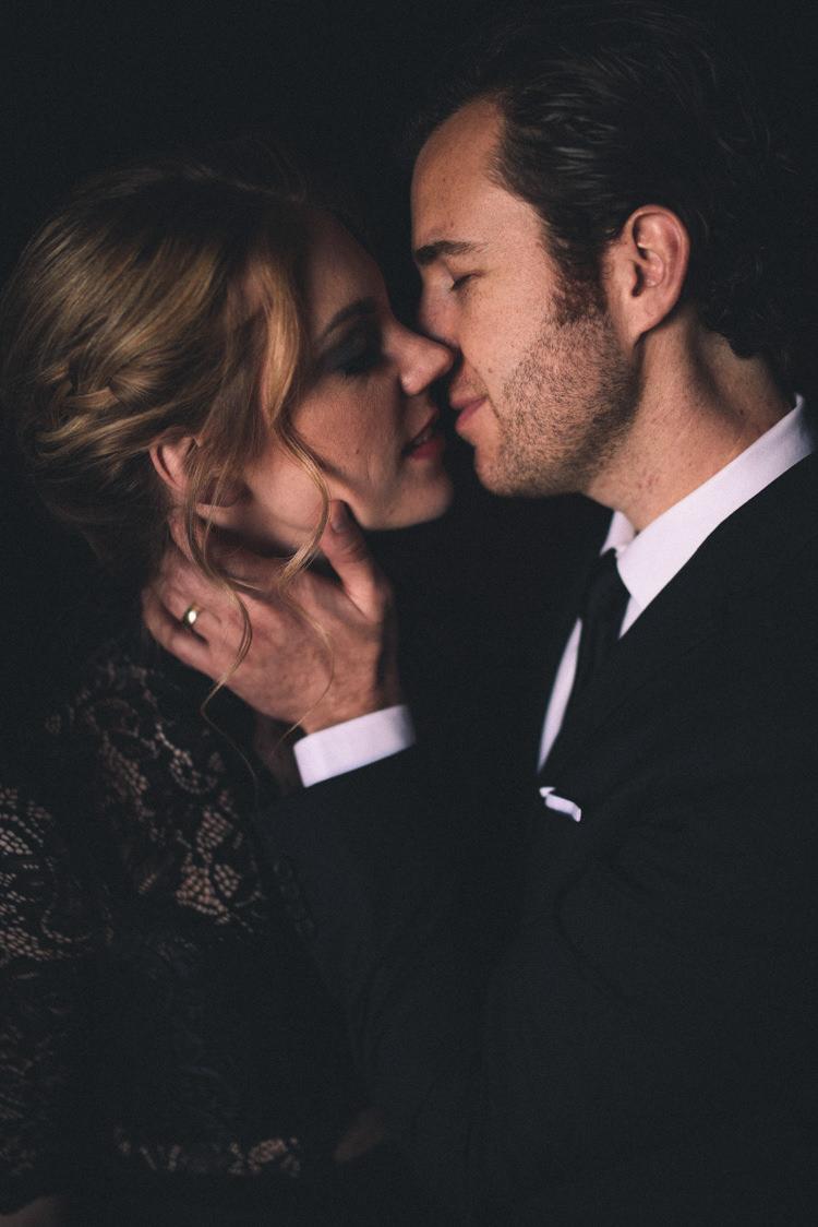Dark Moody Black Dress Bride Groom Updo Kiss | Edgy Emerald City Wedding Ideas http://www.yvonnegollphotography.com/